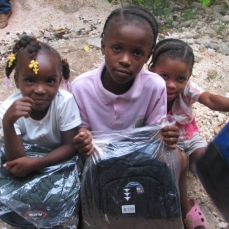 Sponsorship children with new backpacks